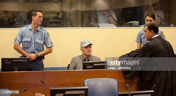 Former Bosnian Serb Military Leader Ratko Mladic takes his seat in the International Criminal Tribunal where he faces war crime charges on June 3...