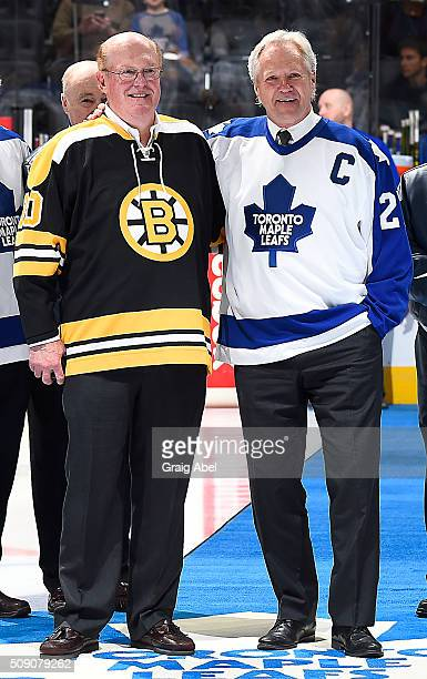 Former Boston Bruin goalie Dave Reece and former Toronto Maple Leaf Darryl Sittler pose for a photo during a pregame ceremony celebrating the 40th...