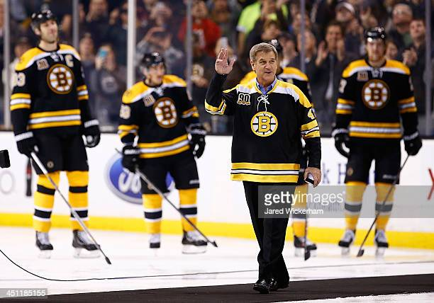 Former Boston Bruins player Bobby Orr walks out to center ice before dropping the puck prior to the game between the Boston Bruins and the St Louis...