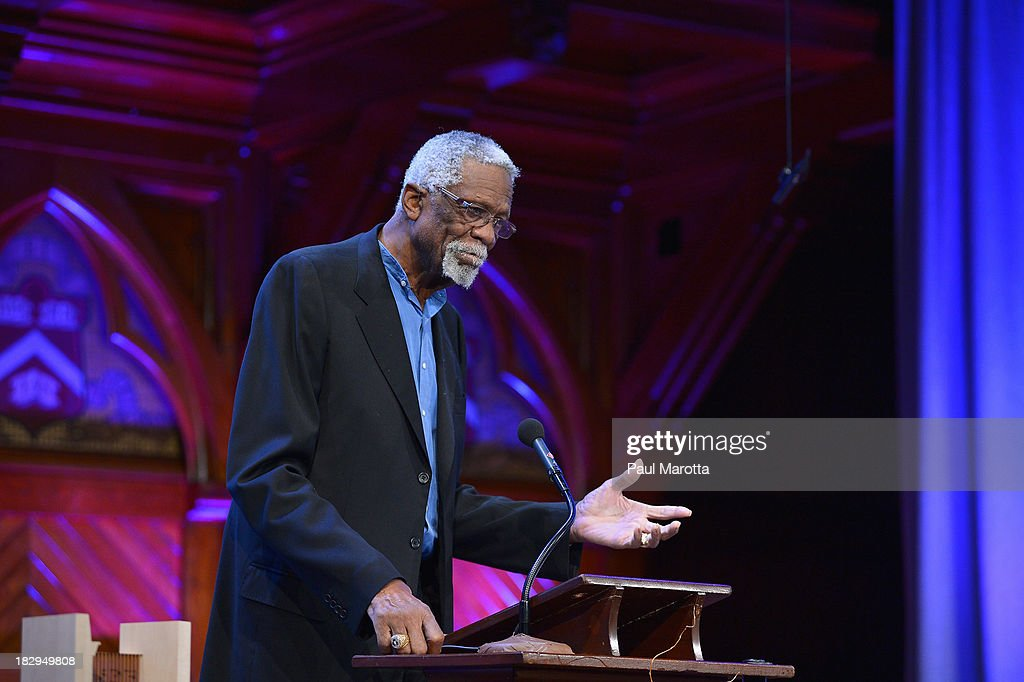 Former Boston Celtic and NBA Hall of Famer Bill Russell presents the 2013 W.E.B. Du Bois Medal to NBA Commissioner David Stern at a ceremony at Harvard University's Sanders Theatre on October 2, 2013 in Cambridge, Massachusetts.
