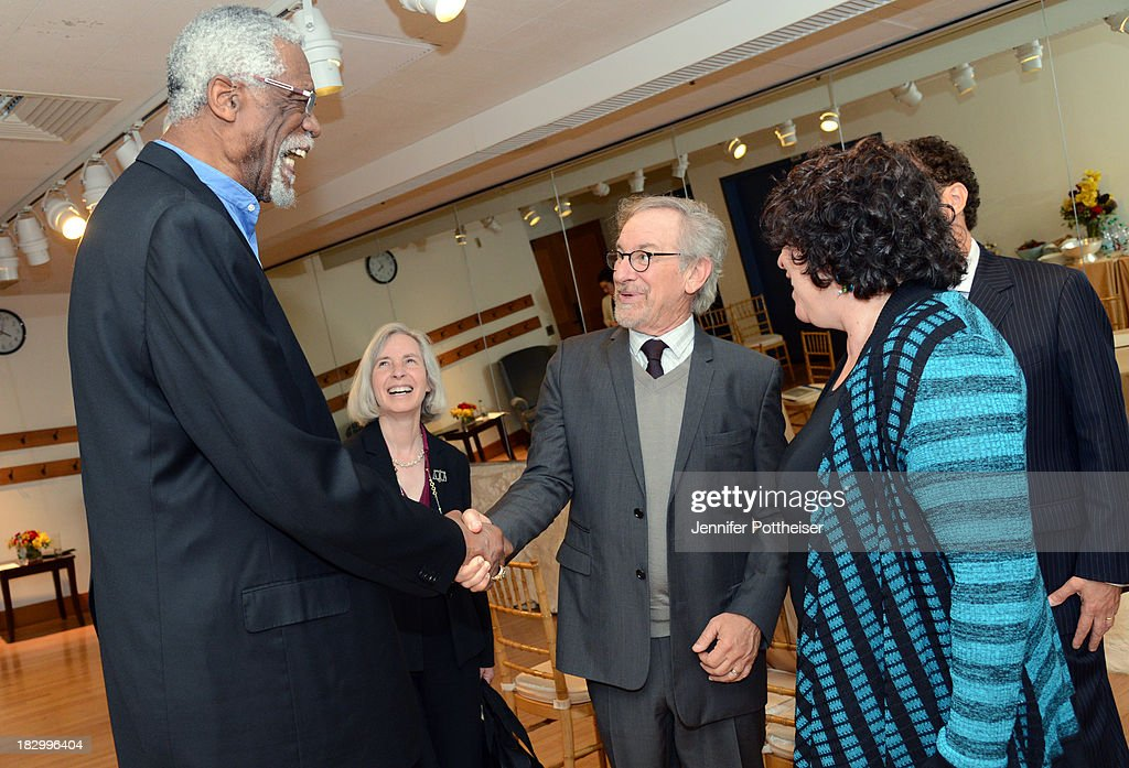Former Boston Celtics player Bill Russell shakes hands with Steven Spielberg at the 2013 W.E.B. Du Bois Medal at a ceremony at Harvard University's Sanders Theatre on October 2, 2013 in Cambridge, Massachusetts.