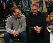 Former Boston Celtics teammates and now NBA team executives Danny Ainge left with the Celtics and Larry Bird with the Indiana Pacers chat during...