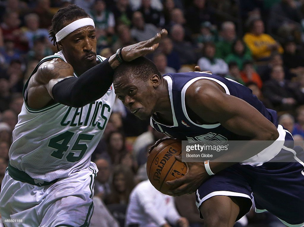 Former Boston College star Oklahoma City Thunder point guard Reggie Jackson (#15) is fouled by Boston Celtics small forward Gerald Wallace (#45) as he drives to the basket n the third quarter. The Boston Celtics take on the Oklahoma City Thunder at TD Garden.