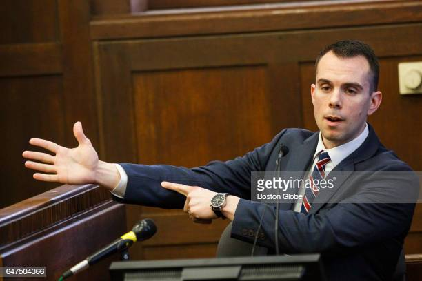 Former Boston EMT Todd Rich points to his arm to describe a gun shot wound as he delivers testimony during the double murder trial of former New...