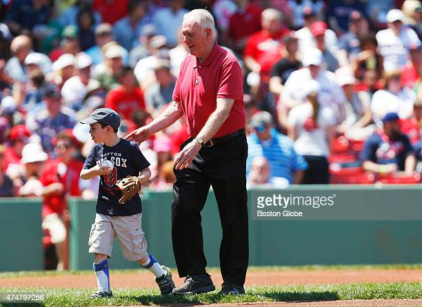 Former Boston Mayor Ray Flynn right walks off of the field with grandson Braeden after they threw out the ceremonial first pitch before the start of...