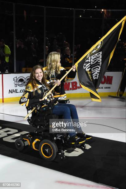 Former Boston Pride hockey player Denna Laing waves a flag before the game of the Boston Bruins against the Ottawa Senators in Game Four of the...