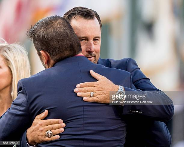 Former Boston Red Sox catcher Jason Varitek hugs former Boston Red Sox pitcher Tim Wakefield during a Red Sox Hall of Fame Class of 2016 ceremony...
