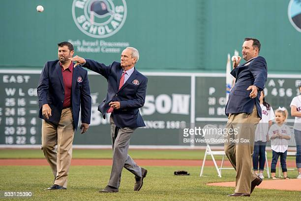 Former Boston Red Sox catcher Jason Varitek President CEO Emeritus Larry Lucchino and former pitcher Tim Wakefield throw out a ceremonial first pitch...