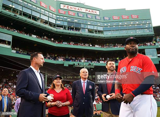 Former Boston Red Sox catcher Jason Varitek President CEO Emeritus Larry Lucchino and former pitcher Tim Wakefield throw out the ceremonial first...