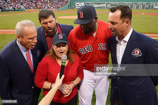 Former Boston Red Sox catcher Jason Varitek President CEO Emeritus Larry Lucchino and former pitcher Tim Wakefield say 'play ball' during a Red Sox...