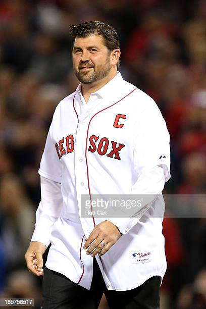 Former Boston Red Sox Jason Varitek takes the field before Game Two of the 2013 World Series between the Boston Red Sox and the St Louis Cardinals at...