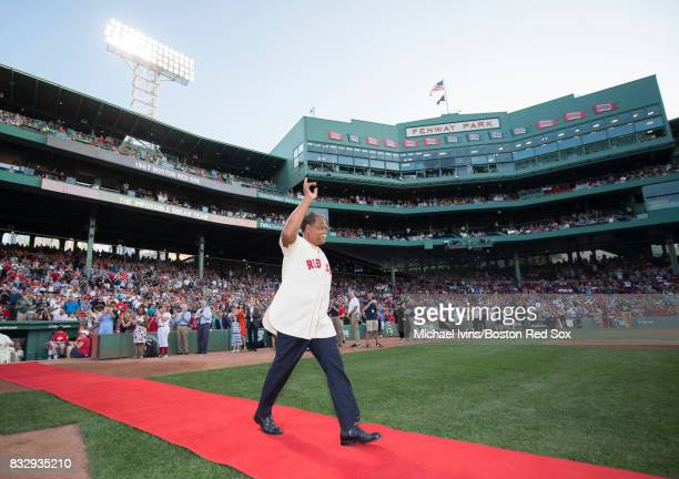 Former Boston Red Sox outfielder Reggie Smith waves to the crowd while being introduced during a ceremony honoring the 1967 'Impossible Dream' team...