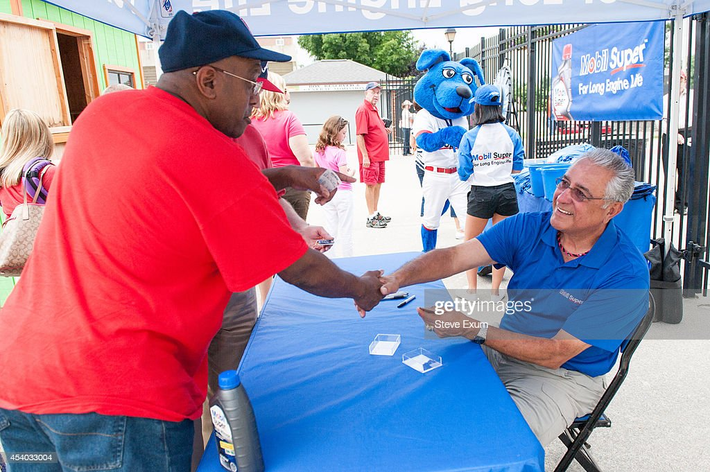 Former Boston Red Sox pitcher Mike Torrez shakes hands with baseball fan George Lester outside Salem Memorial Ball Park before a Salem Red Sox game as part of Mobil Super 'Go the Distance' Baseball Tour August 23, 2014 in Salem, Virginia. Torrez joined the Mobil Super team to meet fans and give away autographed baseballs and other prizes.