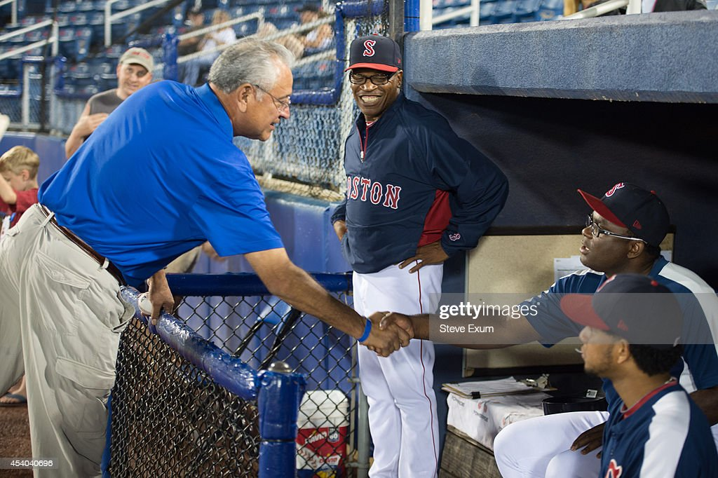 Former Boston Red Sox pitcher Mike Torrez shakes hands with Salem Red Sox team manager <a gi-track='captionPersonalityLinkClicked' href=/galleries/search?phrase=Carlos+Febles&family=editorial&specificpeople=234975 ng-click='$event.stopPropagation()'>Carlos Febles</a> following the ceremonial first pitch at Salem Memorial Ballpark August 23, 2014 in Salem, Virginia. Torrez joined the Mobil Super 'Go the Distance' Baseball Tour for the Salem Red Sox game against the Wilmington Blue Rocks.