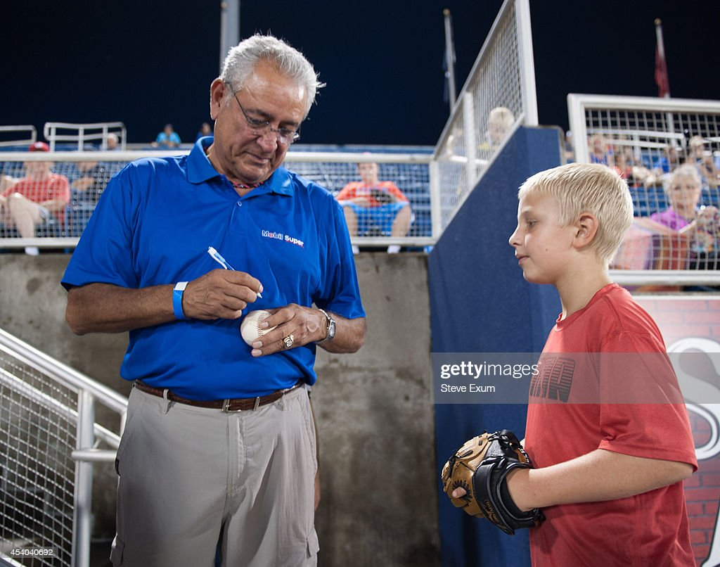 Former Boston Red Sox pitcher Mike Torrez signs a baseball for Salem Red Sox fan Sam Fansler, 9, following the ceremonial first pitch at Salem Memorial Ballpark on Saturday, Aug. 23, 2014 in Salem, Virginia. Torrez joined the Mobil Super ÒGo the DistanceÓ Baseball Tour for the Salem Red Sox game against the Wilmington Blue Rocks.