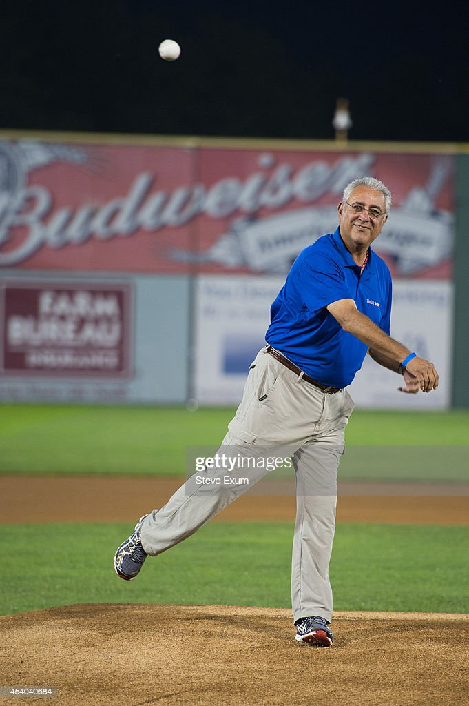 Former Boston Red Sox pitcher Mike Torrez throws the ceremonial first pitch at Salem Memorial Ballpark August 23, 2014 in Salem, Virginia. Torrez joined the Mobil Super ÒGo the DistanceÓ Baseball Tour for the Salem Red Sox game against the Wilmington Blue Rocks.