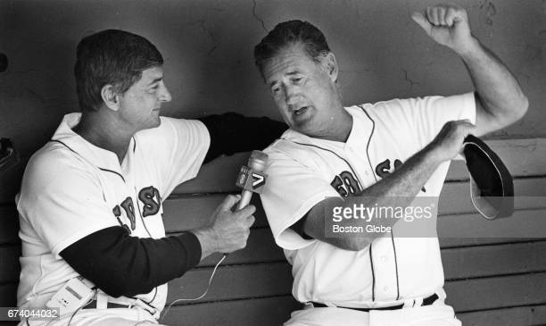 Former Boston Red Sox player Carl Yastrzemski interviews fellow former player Ted Williams during the Old Timers game at Fenway Park in Boston on May...