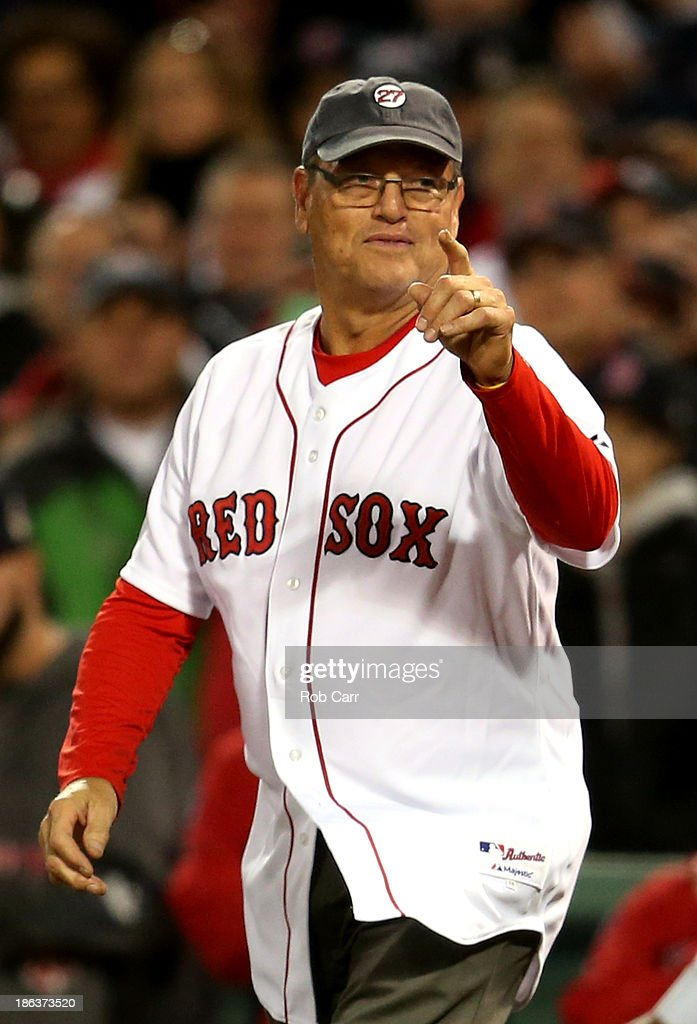Former Boston Red Sox player <a gi-track='captionPersonalityLinkClicked' href=/galleries/search?phrase=Carlton+Fisk&family=editorial&specificpeople=211610 ng-click='$event.stopPropagation()'>Carlton Fisk</a> reacts before throwing out the ceremonial first pitch prior to Game Six of the 2013 World Series between the Boston Red Sox and the St. Louis Cardinals at Fenway Park on October 30, 2013 in Boston, Massachusetts.
