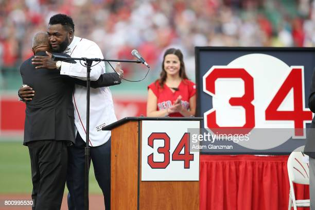 Former Boston Red Sox player David Ortiz embraces his father Americo Enrique Ortiz during the David Ortiz jersey retirement ceremony before a game...