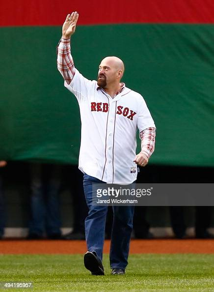 Former Boston Red Sox player Kevin Youkilis is honored prior to the game between the Boston Red Sox and Atlanta Braves at Fenway Park on May 28 2014...