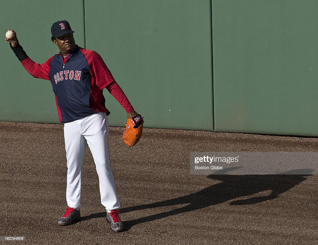 Former Boston Red Sox player Pedro Martinez plays catch with his son in the outfield before the start of the exhibition season opener during spring training at JetBlue Park on Thursday, Feb. 21, 2013.