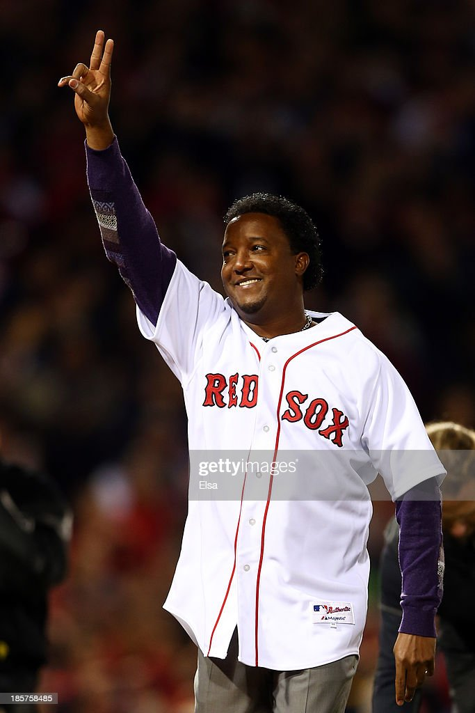 Former Boston Red Sox player Pedro Martinez waves to the crowd before throwing out a ceremonial first pitch prior to Game Two of the 2013 World Series against the St. Louis Cardinals at Fenway Park on October 24, 2013 in Boston, Massachusetts.