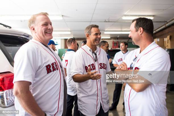 Former Boston Red Sox players Curt Schilling Mike Lowell and Tim Wakefield talk during a 2007 World Series Champion team reunion before a game...