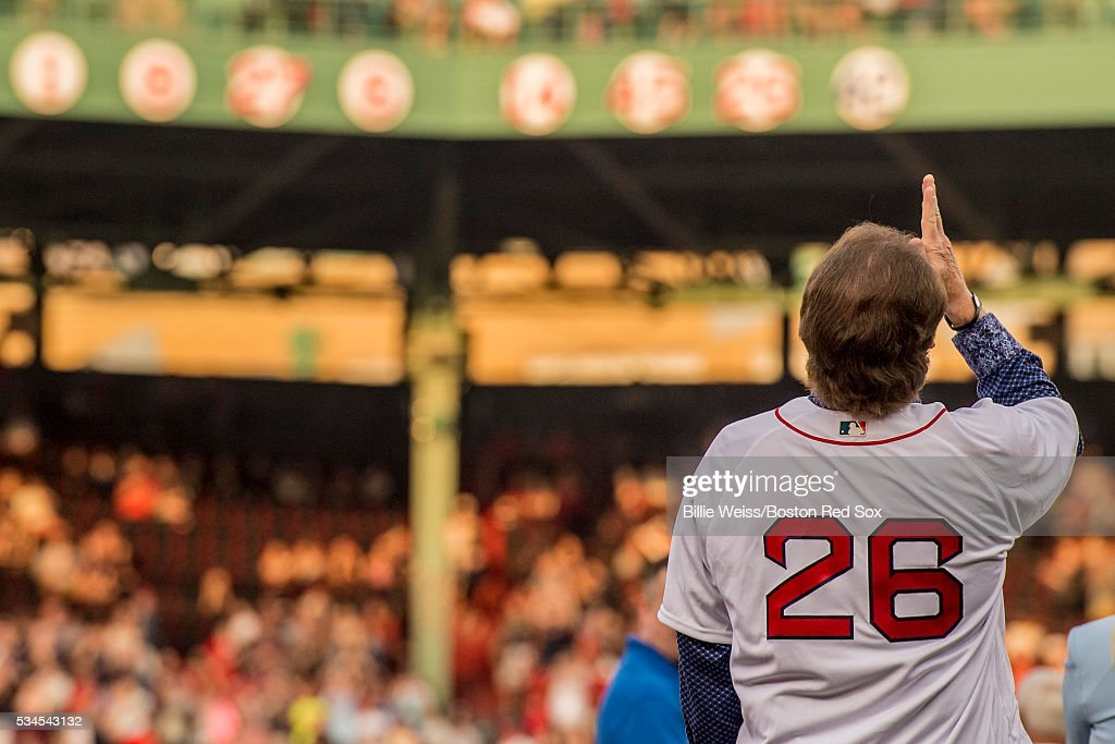 Former Boston Red Sox third baseman Wade Boggs reacts as his jersey number is unveiled during a special number retirement ceremony before a game between the Boston Red Sox and the Colorado Rockies on May 26, 2016 at Fenway Park in Boston, Massachusetts.