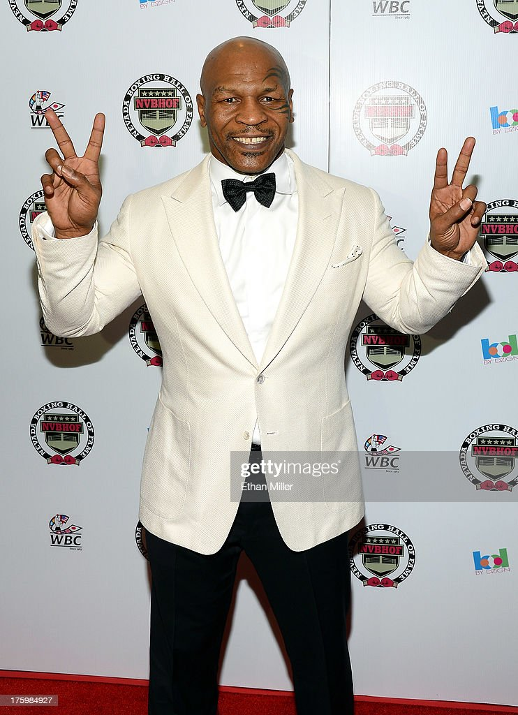 Former boxer and inductee Mike Tyson arrives at the Nevada Boxing Hall of Fame inaugural induction gala at the Monte Carlo Resort and Casino on August 10, 2013 in Las Vegas, Nevada.
