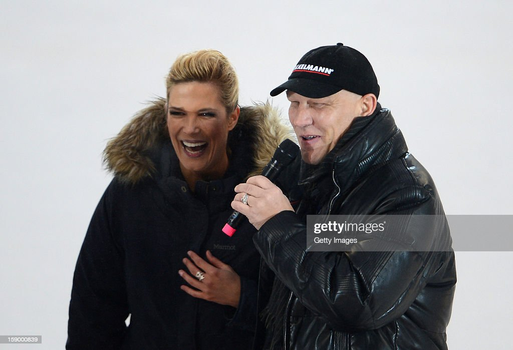 Former boxer Axel Schulz (R) gives an interview during the DEL Winter Game 2013 at Stadion Nuernberg on January 5, 2013 in Nuremberg, Germany.