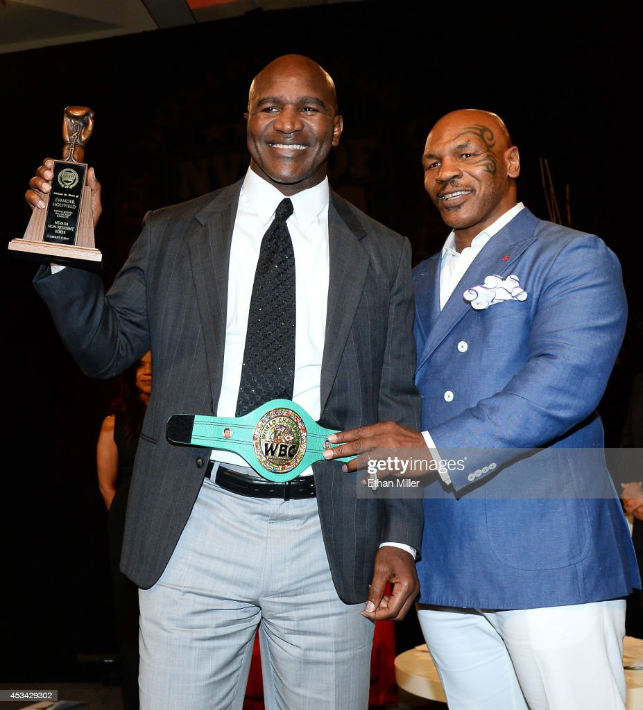 Former boxer <a gi-track='captionPersonalityLinkClicked' href=/galleries/search?phrase=Evander+Holyfield&family=editorial&specificpeople=194938 ng-click='$event.stopPropagation()'>Evander Holyfield</a> (L) is inducted into the Nevada Boxing Hall of Fame by former boxer <a gi-track='captionPersonalityLinkClicked' href=/galleries/search?phrase=Mike+Tyson&family=editorial&specificpeople=194986 ng-click='$event.stopPropagation()'>Mike Tyson</a> at the second annual induction gala at the New Tropicana Las Vegas on August 9, 2014 in Las Vegas, Nevada.