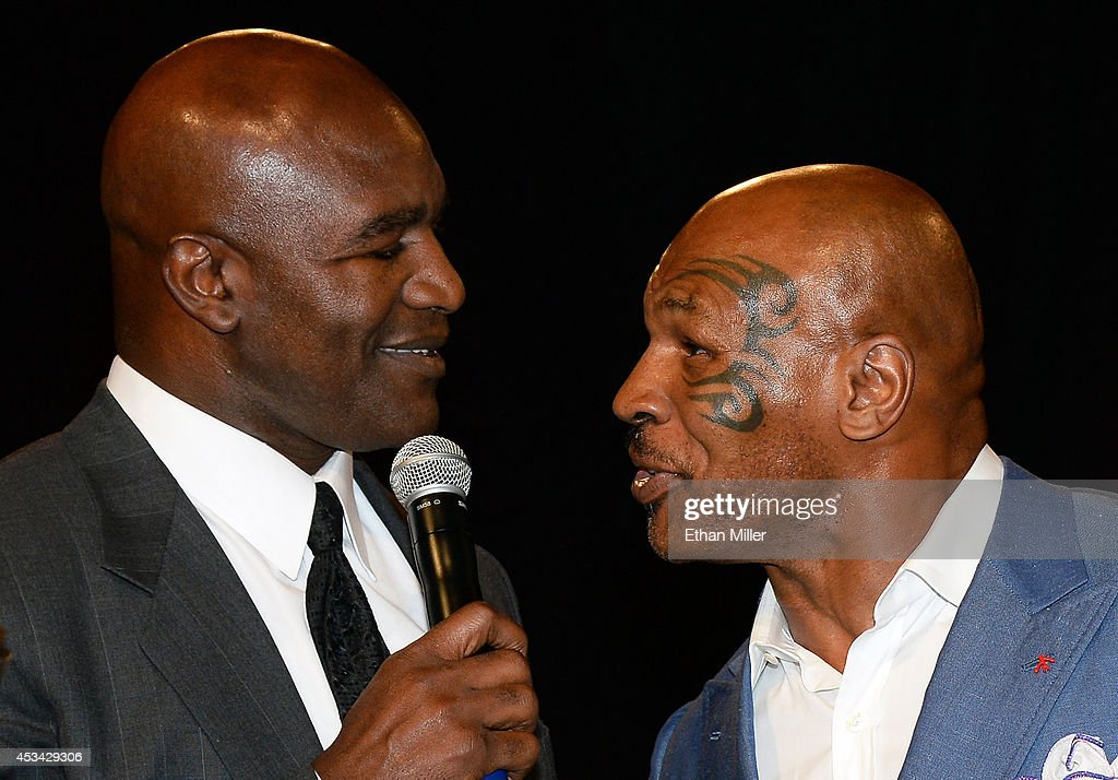 Former boxer Evander Holyfield (L) is inducted into the Nevada Boxing Hall of Fame by former boxer Mike Tyson at the second annual induction gala at the New Tropicana Las Vegas on August 9, 2014 in Las Vegas, Nevada.