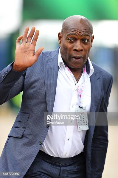 Former boxer Frank Bruno walks in the Paddock before the Formula One Grand Prix of Great Britain at Silverstone on July 10 2016 in Northampton England