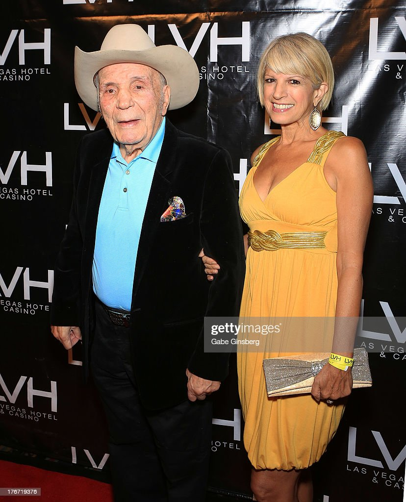 Former boxer Jake 'The Raging Bull' LaMotta (L) and fiancee Denise Baker arrive at the 'Night of the Champion' event to honor former boxer Leon Spinks hosted by the cast members of 'Raiding the Rock Vault' at The Las Vegas Hotel & Casino on August 17, 2013 in Las Vegas, Nevada.