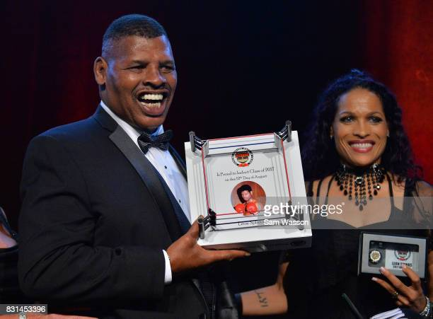 Former boxer Leon Spinks poses for a photo with Rasheda Ali daughter of late boxer Muhammed Ali as Spinks is inducted into the Nevada Boxing Hall of...