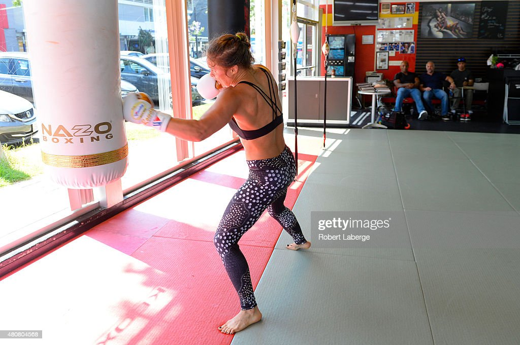Former boxer Mike Tyson and UFC CEO Lorenzo Fertitta watch UFC Bantamweight champion Ronda Rousey during a media training session at the Glendale...