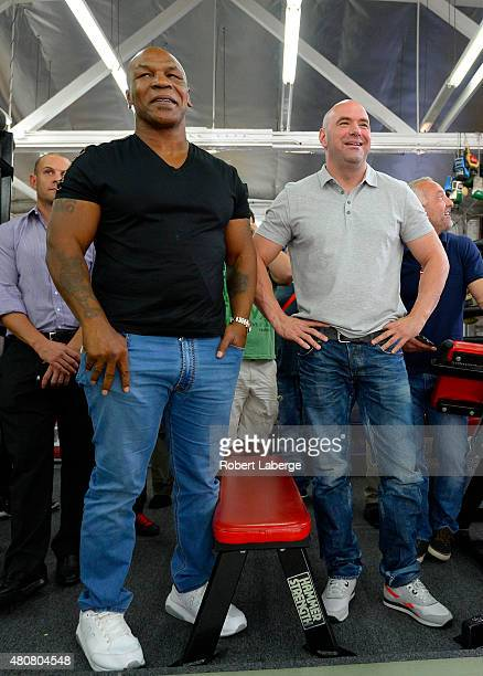 Former boxer Mike Tyson and UFC president Dana White watch UFC Bantamweight champion Ronda Rousey during a media training session at the Glendale...