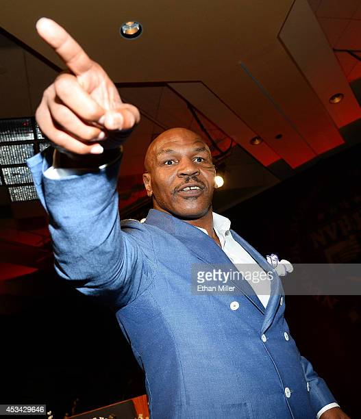 Former boxer Mike Tyson gestures to the crowd as he inducts Evander Holyfield into the Nevada Boxing Hall of Fame at the second annual induction gala...
