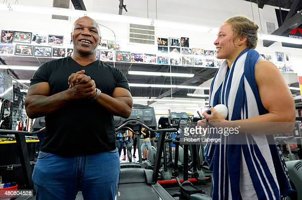 Former boxer Mike Tyson meets UFC Bantamweight champion Ronda Rousey during a media training session at the Glendale Fight Club on July 15 2015 in...