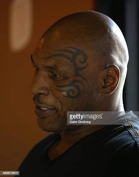 Former boxer Mike Tyson tattoo detail is interviewed as he attends launch of the world's first Mike Tyson Bitcoin ATM machine at Off The Strip at The...
