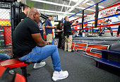 Former boxer Mike Tyson watches UFC Bantamweight champion Ronda Rousey during a media training session at the Glendale Fight Club on July 15 2015 in...