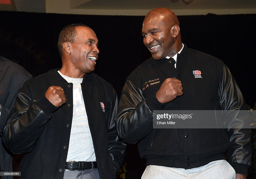 Former boxers <a gi-track='captionPersonalityLinkClicked' href=/galleries/search?phrase=Sugar+Ray+Leonard&family=editorial&specificpeople=206479 ng-click='$event.stopPropagation()'>Sugar Ray Leonard</a> (L) and <a gi-track='captionPersonalityLinkClicked' href=/galleries/search?phrase=Evander+Holyfield&family=editorial&specificpeople=194938 ng-click='$event.stopPropagation()'>Evander Holyfield</a> pose wearing jackets they were presented for being former United States Olympians at the second annual Nevada Boxing Hall of Fame induction gala at the New Tropicana Las Vegas on August 9, 2014 in Las Vegas, Nevada.