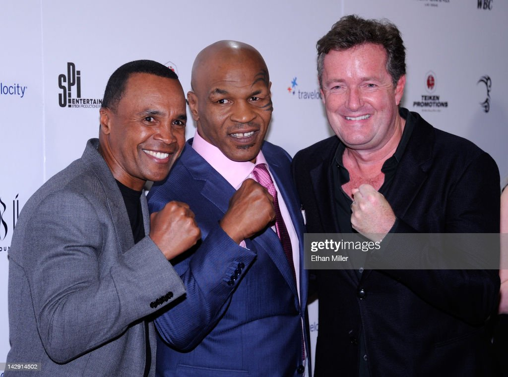 Former boxers Sugar Ray Leonard and <a gi-track='captionPersonalityLinkClicked' href=/galleries/search?phrase=Mike+Tyson&family=editorial&specificpeople=194986 ng-click='$event.stopPropagation()'>Mike Tyson</a> and CNN host <a gi-track='captionPersonalityLinkClicked' href=/galleries/search?phrase=Piers+Morgan&family=editorial&specificpeople=216509 ng-click='$event.stopPropagation()'>Piers Morgan</a> arrive at the grand opening of Tyson's one-man show '<a gi-track='captionPersonalityLinkClicked' href=/galleries/search?phrase=Mike+Tyson&family=editorial&specificpeople=194986 ng-click='$event.stopPropagation()'>Mike Tyson</a>: Undisputed Truth - Live on Stage' at the Hollywood Theatre at the MGM Grand Hotel/Casino April 14, 2012 in Las Vegas, Nevada.