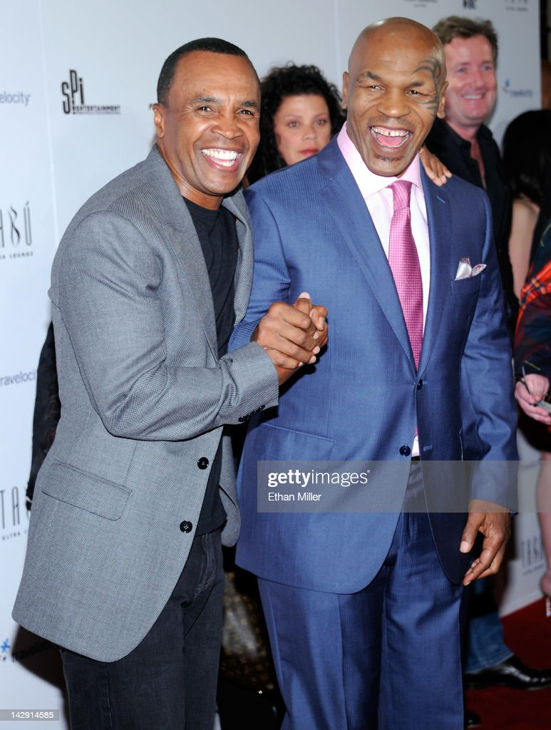 Former boxers Sugar Ray Leonard (L) and <a gi-track='captionPersonalityLinkClicked' href=/galleries/search?phrase=Mike+Tyson&family=editorial&specificpeople=194986 ng-click='$event.stopPropagation()'>Mike Tyson</a> arrive at the grand opening of Tyson's one-man show '<a gi-track='captionPersonalityLinkClicked' href=/galleries/search?phrase=Mike+Tyson&family=editorial&specificpeople=194986 ng-click='$event.stopPropagation()'>Mike Tyson</a>: Undisputed Truth - Live on Stage' at the Hollywood Theatre at the MGM Grand Hotel/Casino April 14, 2012 in Las Vegas, Nevada.