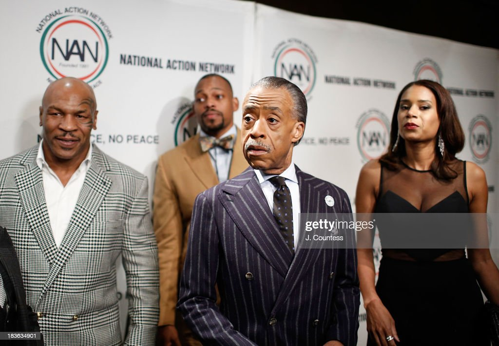 Former Boxing champion Mike Tyson (L) and President and founder of the National Action Network Reverend Al Sharpton (C) backstage at The 4th Annual Triumph Awards at Rose Theater, Jazz at Lincoln Center on October 7, 2013 in New York City.