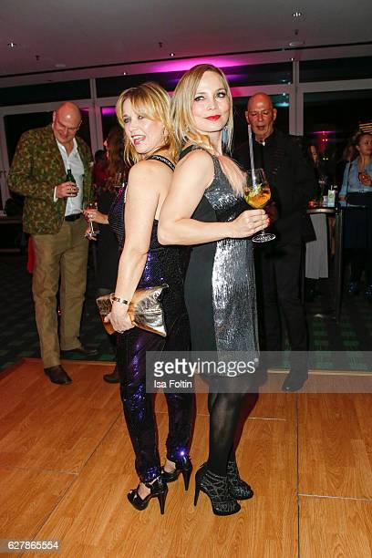 Former boxing champion Regina Halmich and german actress Tina Ruland attend the 1st Anniversary Celebration Of Berlin Blonds on December 5 2016 in...