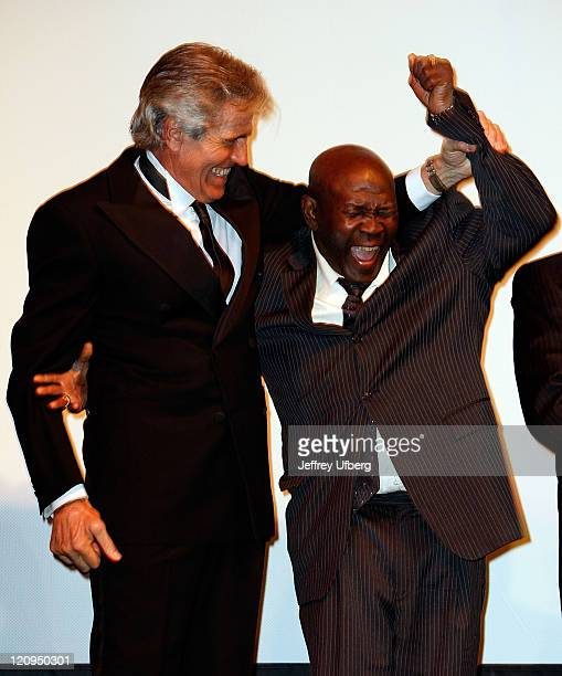 Former boxing champions Nino Benvenuti and Emile Griffith pose for a photo after they are introduced prior to the screening of 'Carnera The Walking...