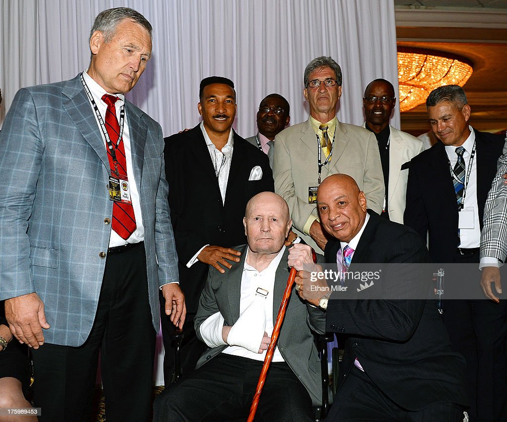 Former boxing referee Mills Lane is flanked by referees including fellow inductee Joe Cortez during the Nevada Boxing Hall of Fame inaugural...