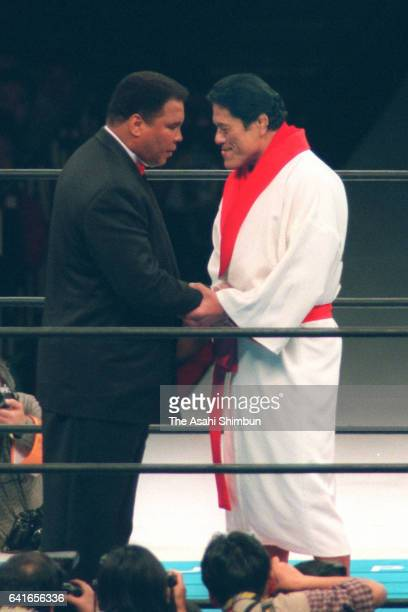 Former boxing world champion Muhammad Ali and professional wrestler Antonio Inoki shake hands at Korakuen Hall on April 4 1998 in Tokyo Japan