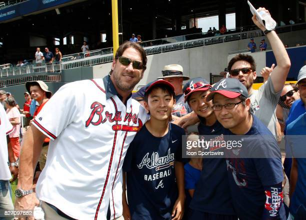 Former Braves player John Rocker takes a photo with fans prior to the MLB game between the Atlanta Braves and the Miami Marlins on August 6 2017 at...